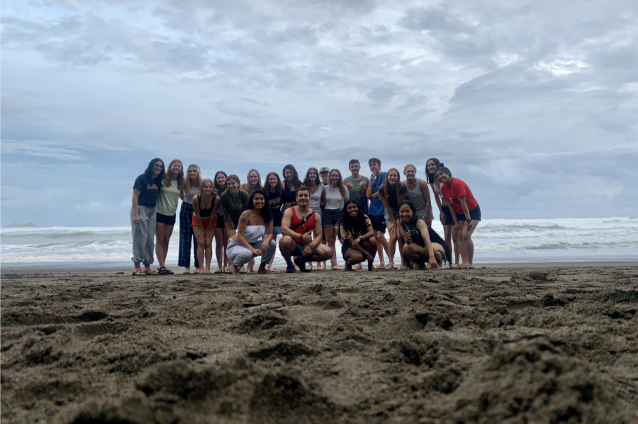 """Attendees of the Global Works """"Costa Rica: Children and Community"""" service trip congregate at Playa Chaman on the penultimate day of their excursion. The trip explored the multifaceted culture of Costa Rica, partaking in work at a rainforest biology station,  volunteering at a local school and surfing with locals."""