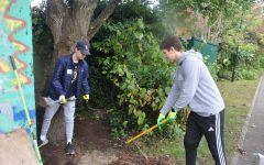 Jack Cutler ('22) and Leyth Sousou ('22) shovel dirt and rake away leaves in order to set up fencing at Pace Fortune Green for Community Volunteer Day Oct. 17. ASL families volunteered at 13 different community volunteer sites on the day.