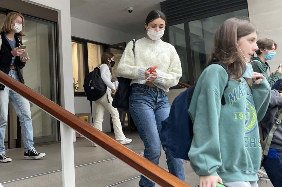 Students wear masks while leaving school campus Oct. 7. As of Oct. 18, masks will no longer be required.