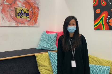 English teacher Joy Xu stands in the corner of the English pod. Xu said she has a special appreciation for the international perspective after living in multiple countries and serving as a DEI chair at her last school in San Francisco.