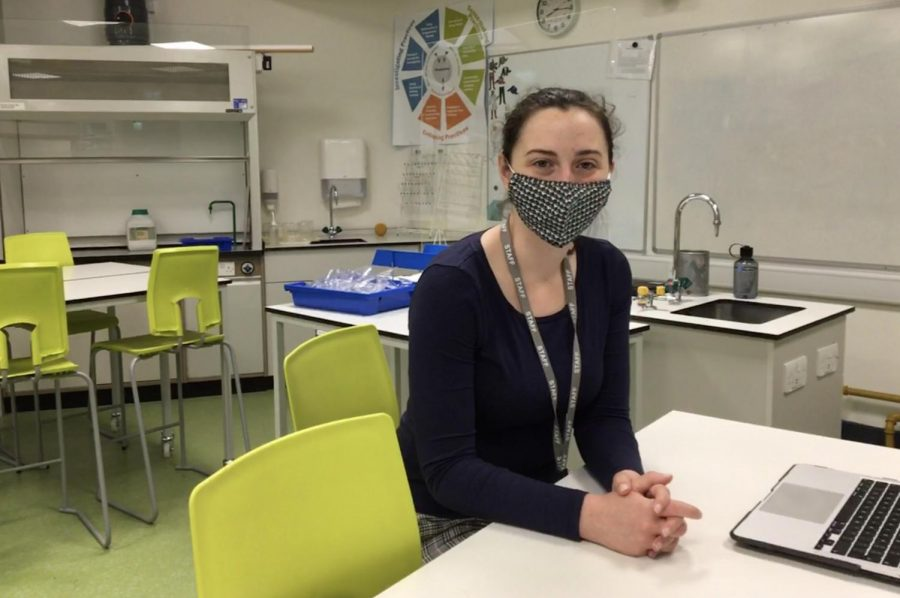 HS Science Teacher Corinne sits in science classroom W-302. Morgan has lived in London for six years and is new to ASL this year.
